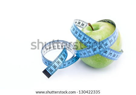Dieting concept green apple with measuring tape isolated on white