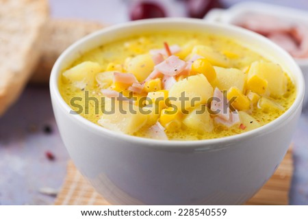 Dieting healthy potato soup with ham - stock photo