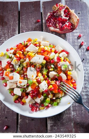 Dieting healthy salad with cheese and pomegranate - stock photo