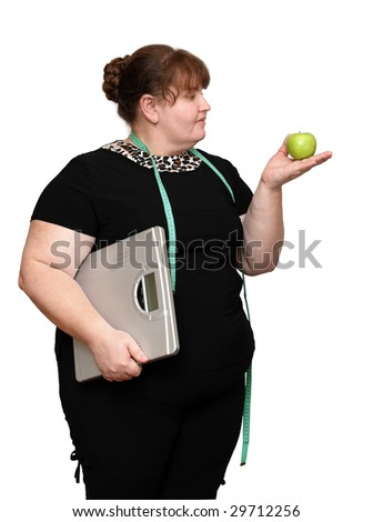dieting overweight woman with apple and scales - stock photo