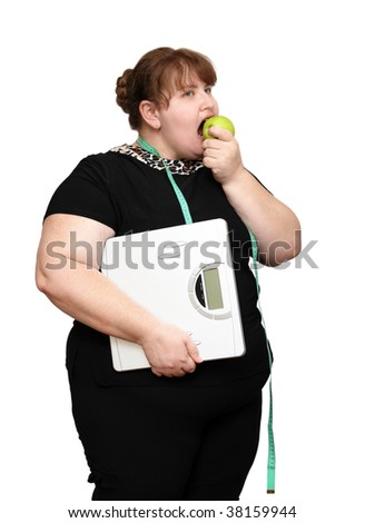 dieting overweight women with scales and apple - stock photo