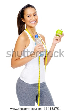 Dieting woman with measuring tape and apple showing healthy eating and weightloss concept isolated on white - stock photo