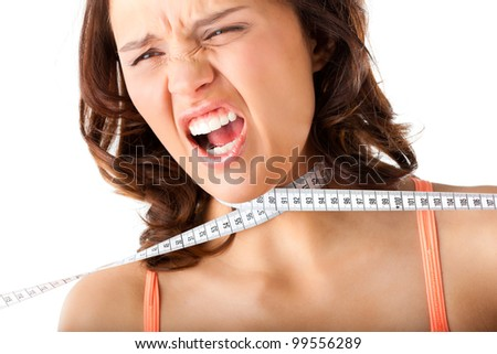 Dieting - young woman is choking herself literally with measuring tape - stock photo
