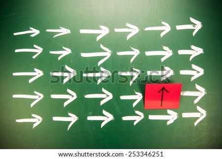 Difference innovation concept. One different direction in the arrow group - stock photo
