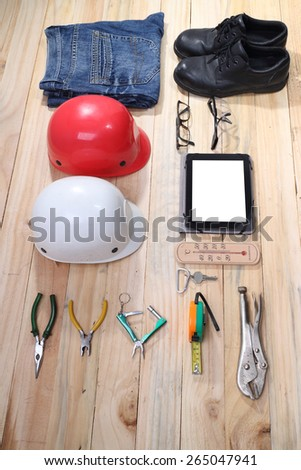 difference tool of safety set and working set on wood background  - stock photo