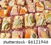 Different appetizers (salmon, tuna, foie gras, olives) close up - stock photo