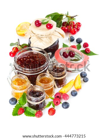 Different berry jam in glass jar isolated on white background. - stock photo