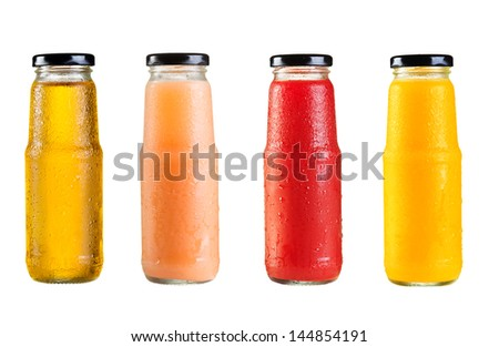 different bottles of juice on white background - stock photo