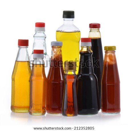 Different bottles of sauce and cooking oil  - stock photo