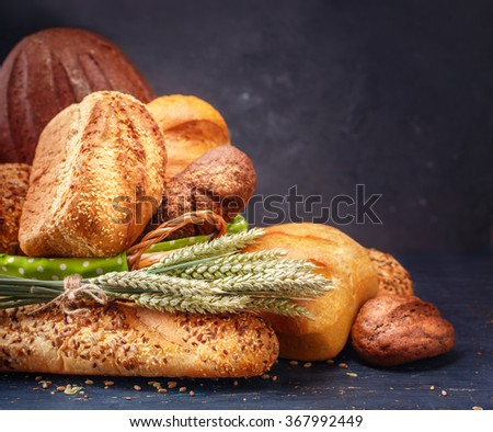 Different bread on a rustic dark background  with copyspace