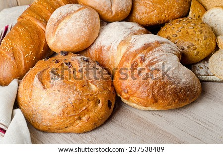 Different bread on  wooden background. Selective focus - stock photo
