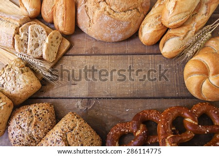 different breads on wood background - stock photo