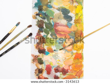 different brushes and color palette - stock photo