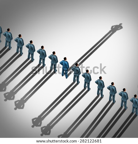 Different business thinking and independent thinker concept and new leadership concept or individuality as a group of people cast shadows with the shadow of one businessman in the opposite direction. - stock photo
