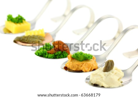 Different canapes. Shallow depth of field. Isolated on white background. Studio work. - stock photo