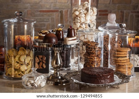 different candy bar glass jars - stock photo