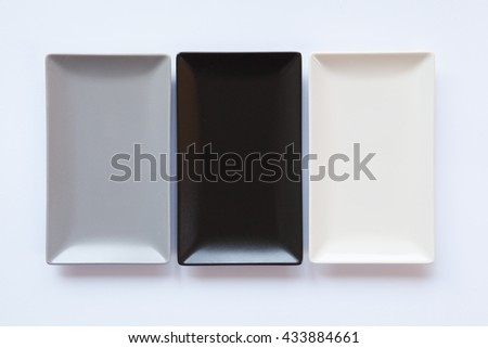 Different  ceramic dishes on over white background, rectangle dish - stock photo