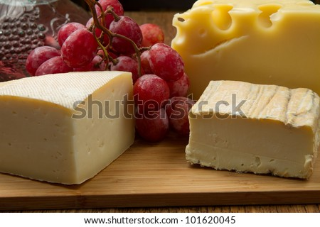 different cheese with red grapes - stock photo
