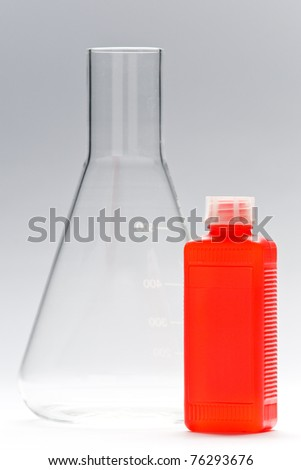different chemistry glasses, bottles and things on white ground