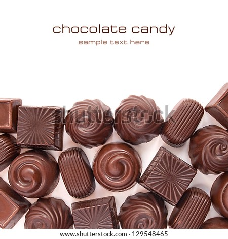 Different chocolate candies over white background - stock photo