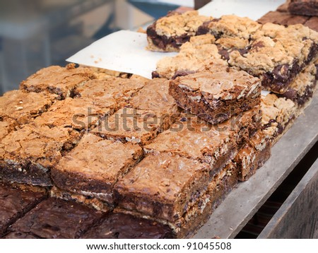 Different Chocolate Nut brownies at the market - stock photo
