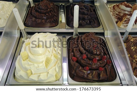 Different chocolates ice cream are shown an italian ice cream parlor. - stock photo