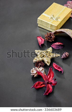 Different Christmas decorations and golden box on the dark background - stock photo