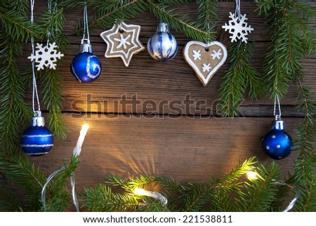 Different Christmas Decorations with Fairy Lights Building a Frame on Wood with Copy Space - stock photo