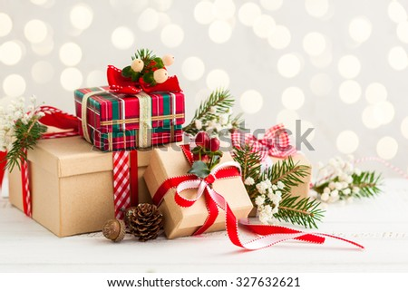Different Christmas presents with handmade decoration - stock photo