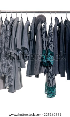 different coat clothes with sundress for females rack display - stock photo