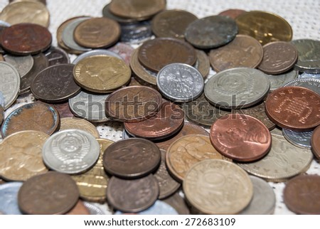 different coins from all over the world - stock photo