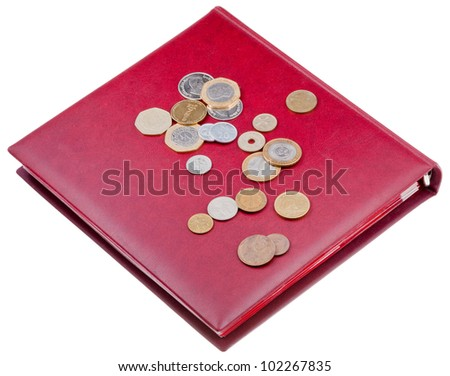 different coins on red numismatics album and  isolated on white