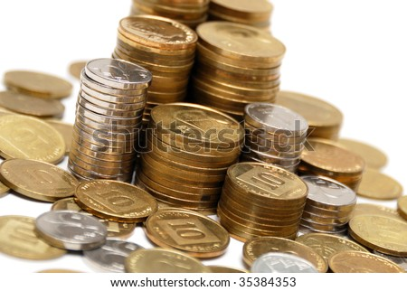 Different coins stacked on white background - stock photo