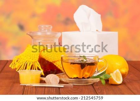 Different cold medicines and napkins on wooden  table - stock photo
