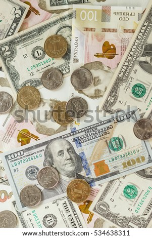 Different collector's coins and banknotes, soft focus background