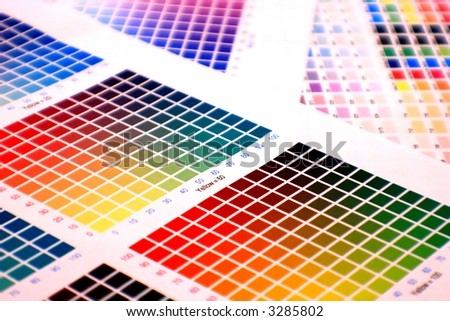 different color charts on white paper - pick your favourite! - stock photo