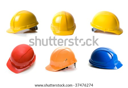 Different color helmets set isolated on white background - stock photo
