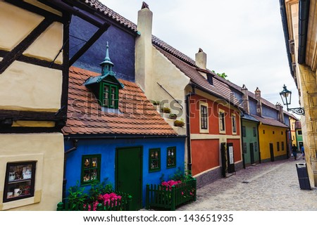 Different color houses on the narrow street, Czech Republic - stock photo