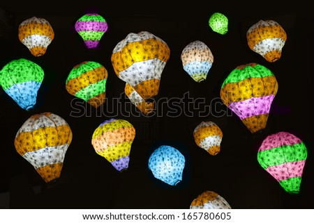 Different color lights against dark background - stock photo