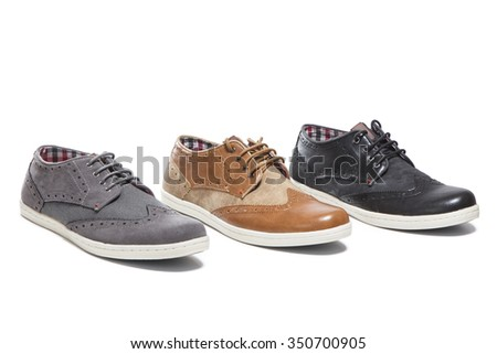 different color of man shoes isolated on a white background