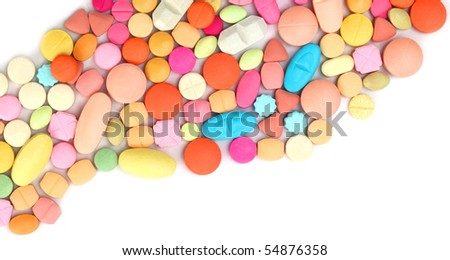 Different color tablets on white background