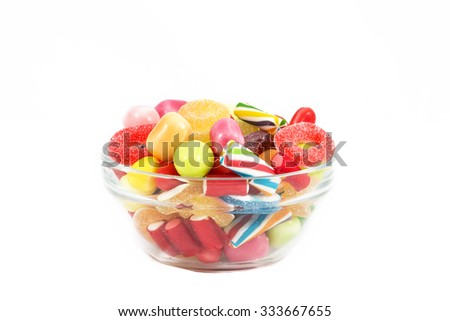 Different colored candies isolated in white background