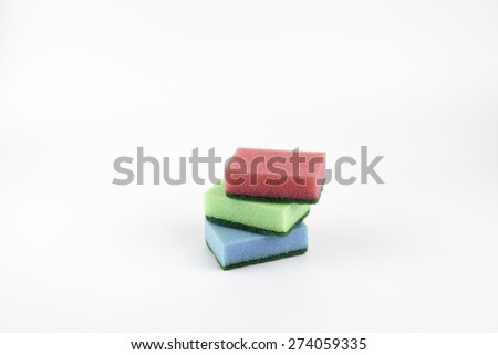 Different colored cleaning sponges. - stock photo