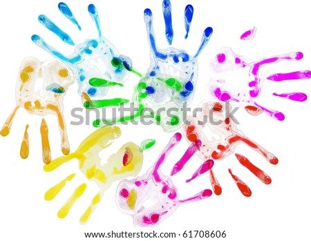 different colored hands overlapping - stock photo