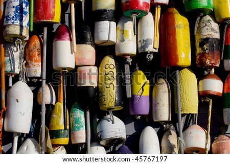 Different colored lobster pots on pier in Maine - stock photo