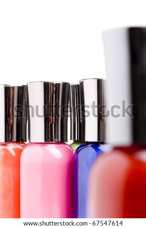 Different colored nail polish bottles on a white background.