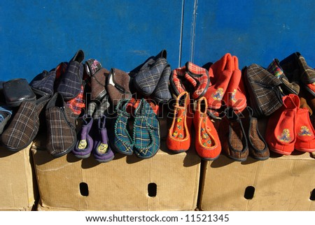Different colored slippers in  a flea market