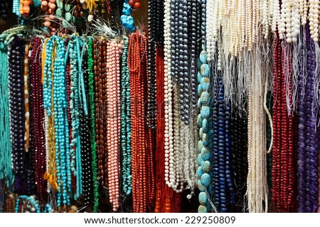 Different colorful beads on the arabic market, Oman - stock photo