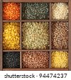 Different colorful lentils in wooden box close up - stock photo