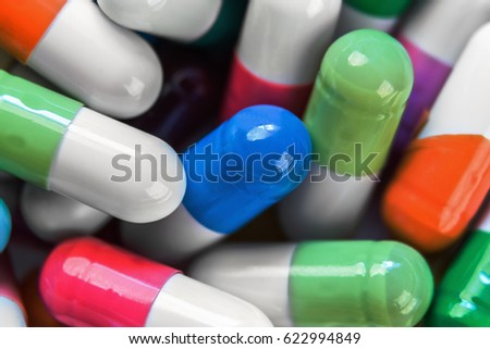 Different colors background of pills. Soft focus and shallow depth of field